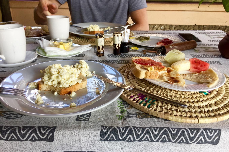 Scrambled egg fruit breakfast at Ambureni Coffee Lodge
