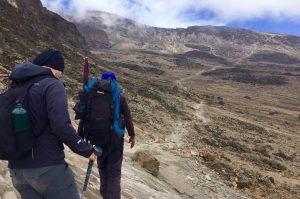 Hiking through stone dessert at Kilimanjaro