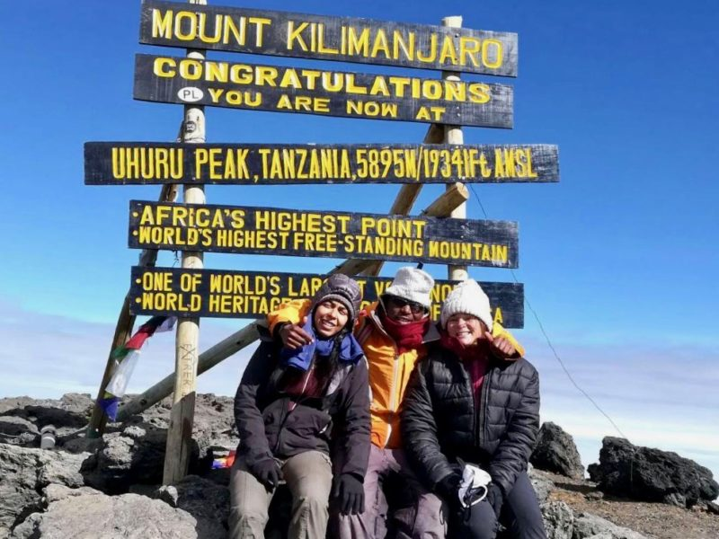 Two mountaineers at the summit of Kilimanjaro