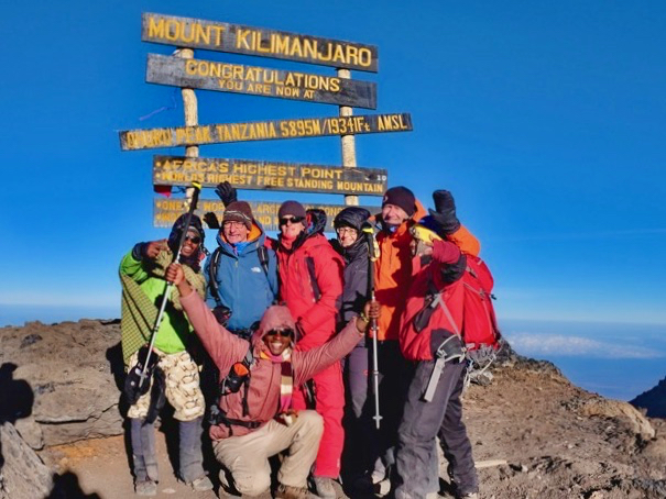 Group ascent of Kilimanjaro in Central Africa shortly after sunrise