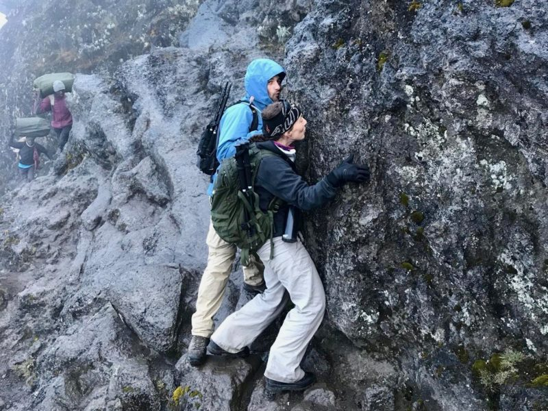 Two mountaineers kiss Kilimanjaro