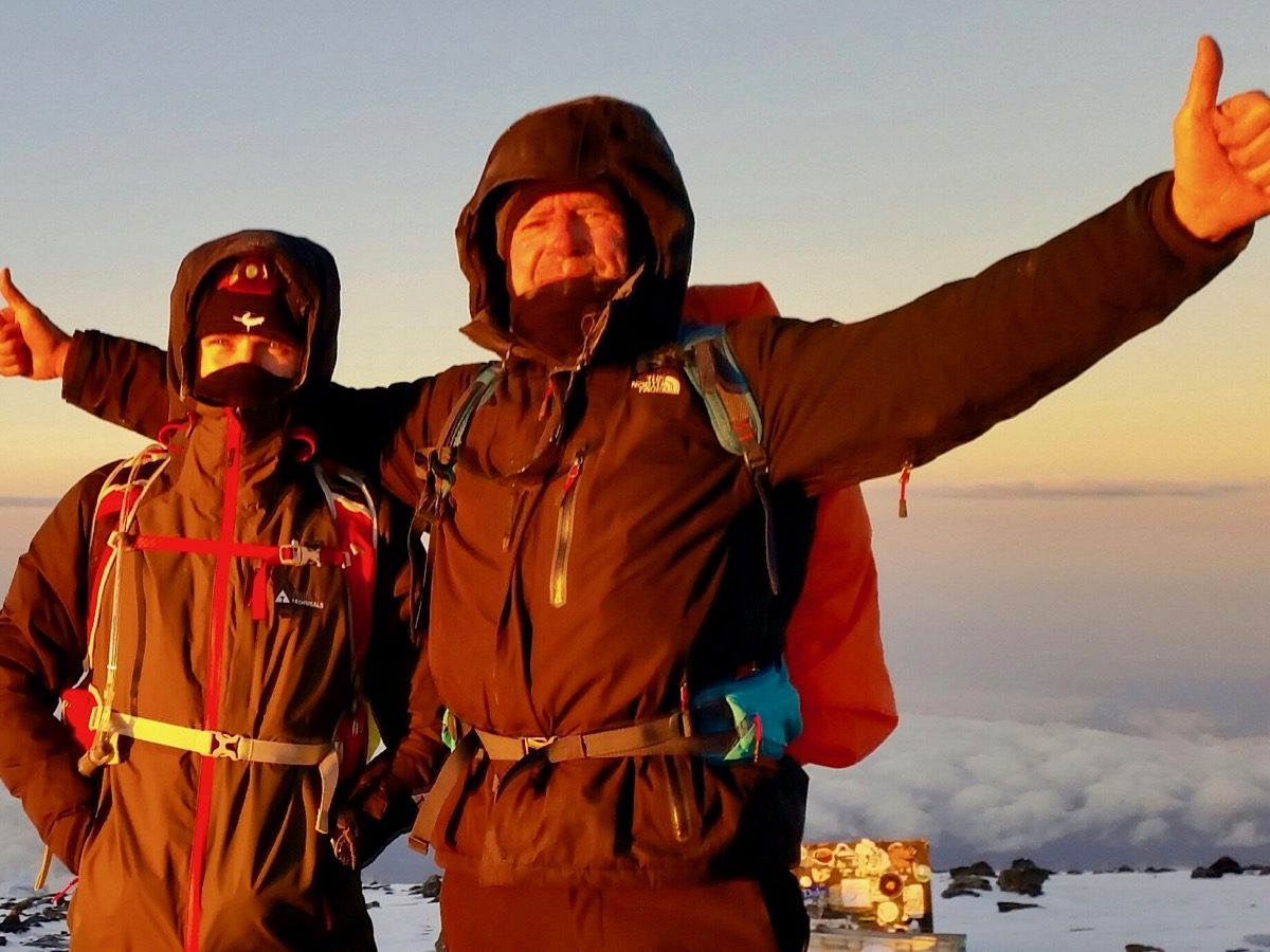 Two summit climbers on the summit of Kilimanjaro