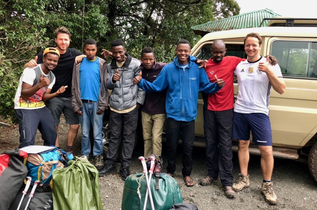 A group of satisfied mountaineers after a successful ascent of Kilimanjaro