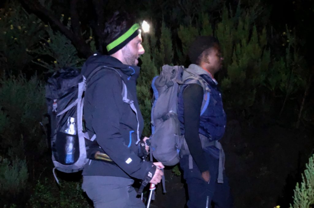 Mountaineers set off at night in the dark to climb Mount Meru.