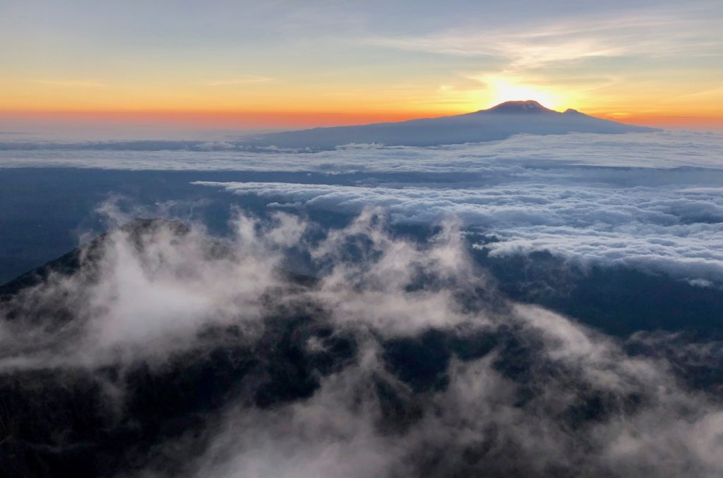 Sunrise at Mount Meru with a view of Kilimanjaro