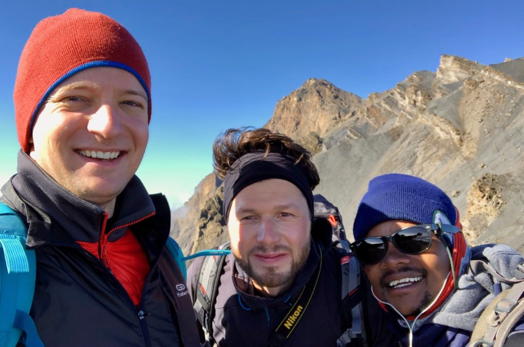 Two mountaineers with guide on Mount Meru